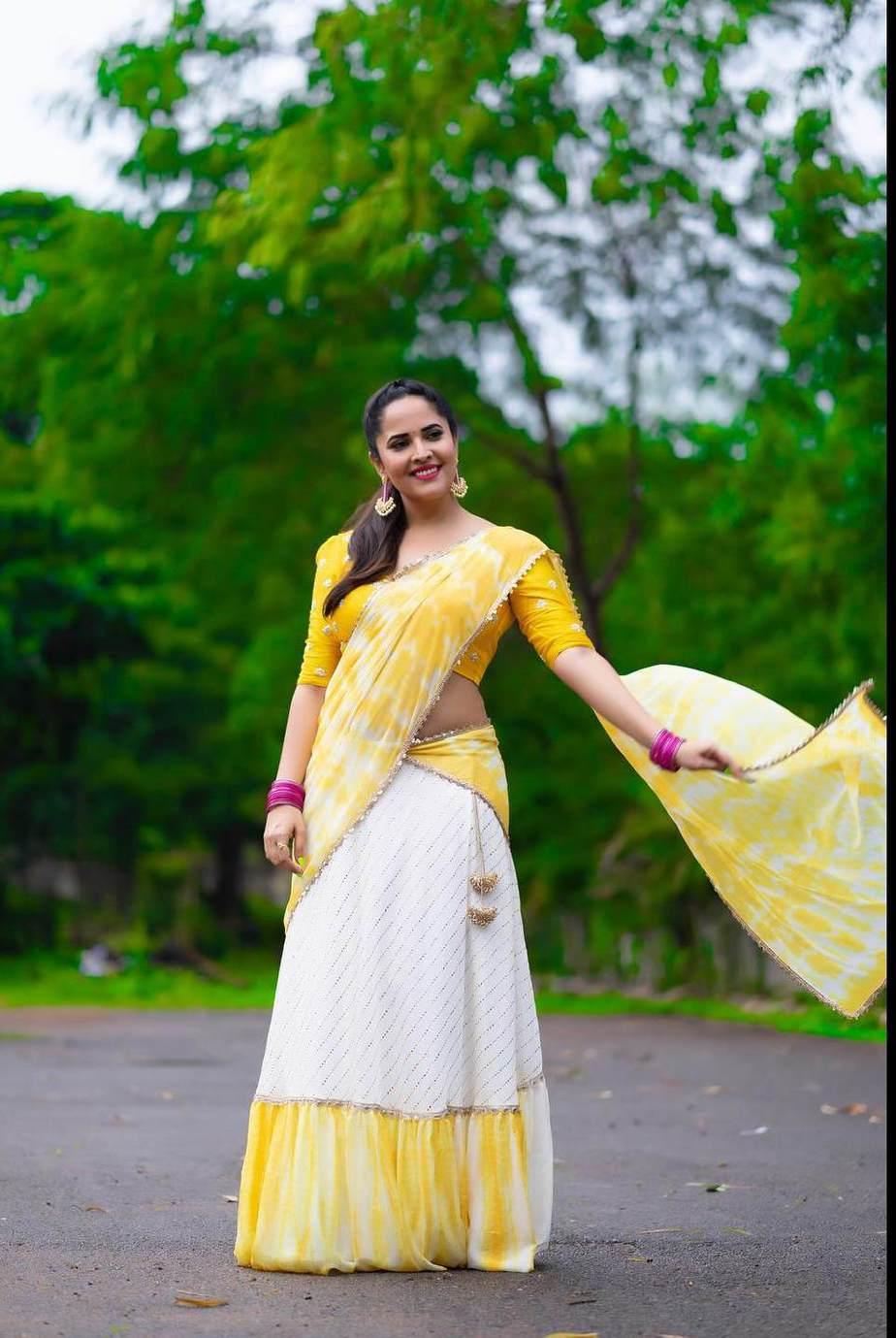 Anasuya Bhradwaj in yellow half saree by Gauri Naidu for Jabardasth