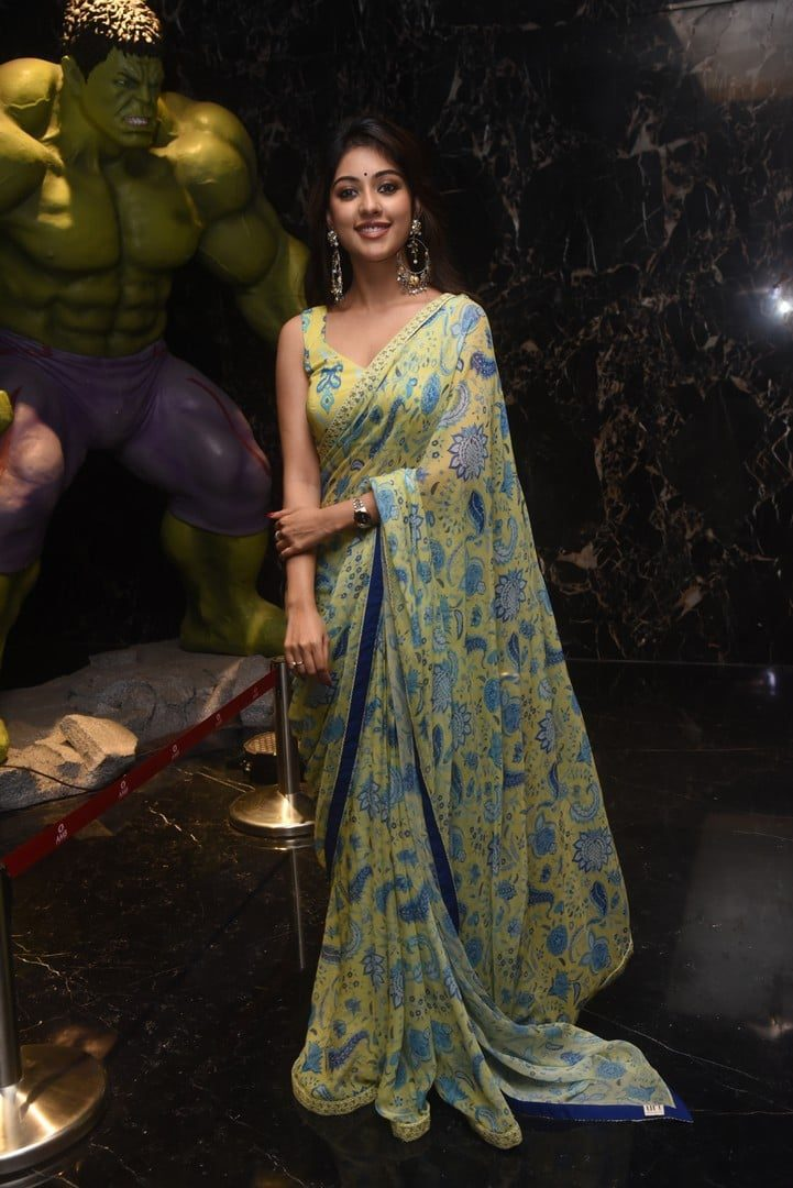 Anu Immanuel in a yellow printed saree for _Mahasamudram_ trailer launch