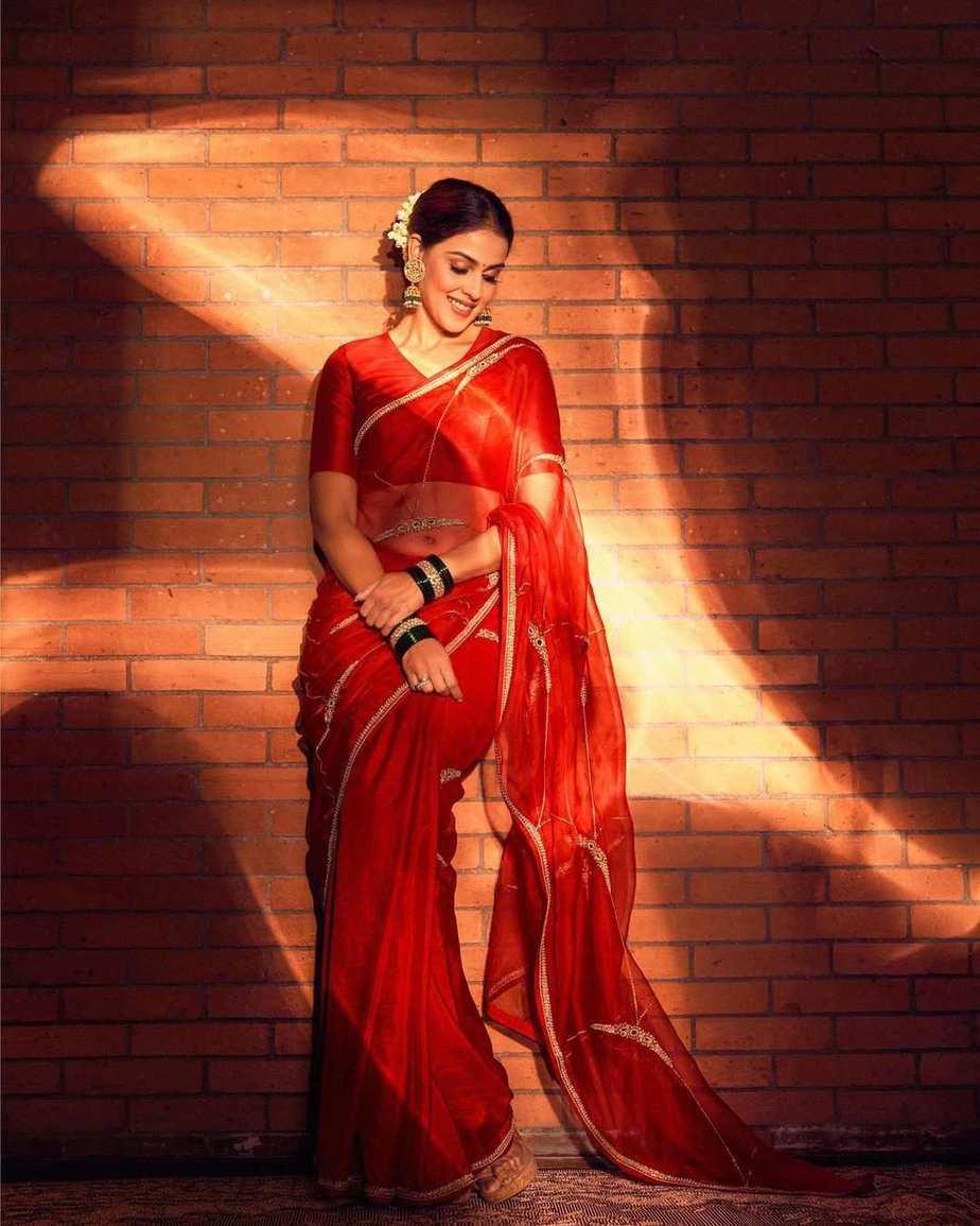 Genelia deshmukh in a red raw mango saree for an ad