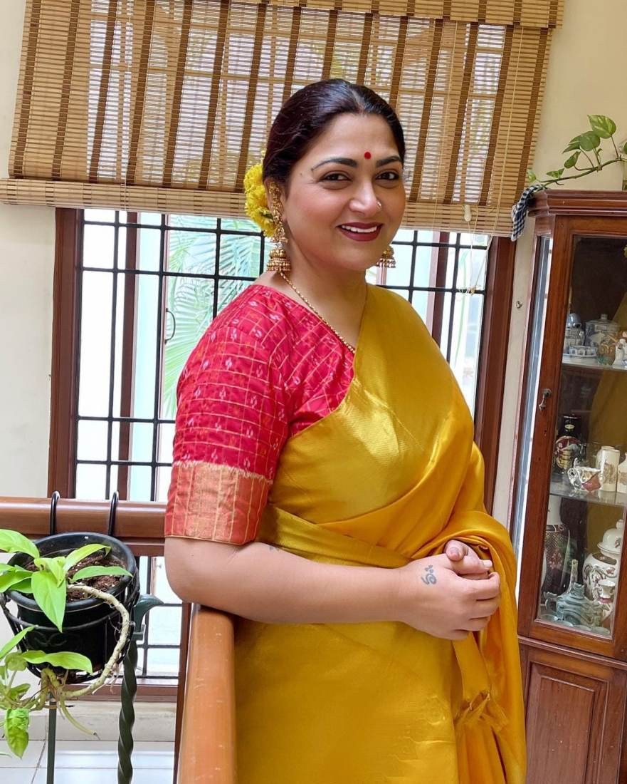Kushboo Sundar in a yellow pattu saree for Ganesh Chaturthi