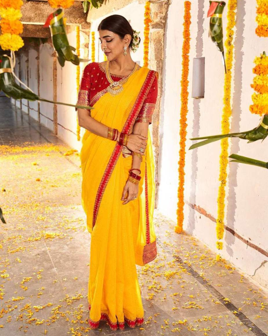 Lakshmi Manchu in a yellow silk saree