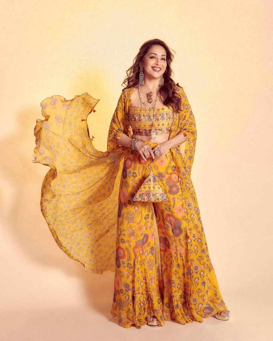 Madhuri Dixit in a yellow cape set by Diya Rajvvir for Dance deewane