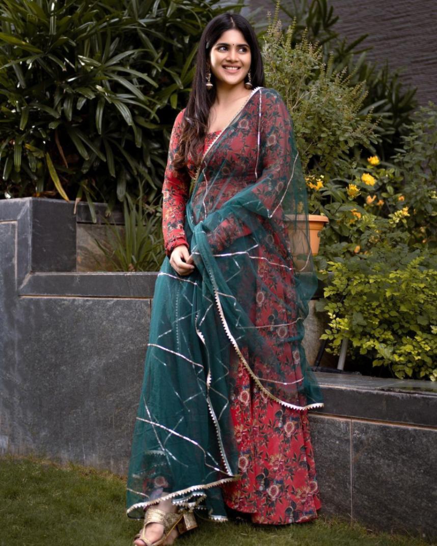 Megha Akash in a geethika Kanumili red floral anarkali for dear megha
