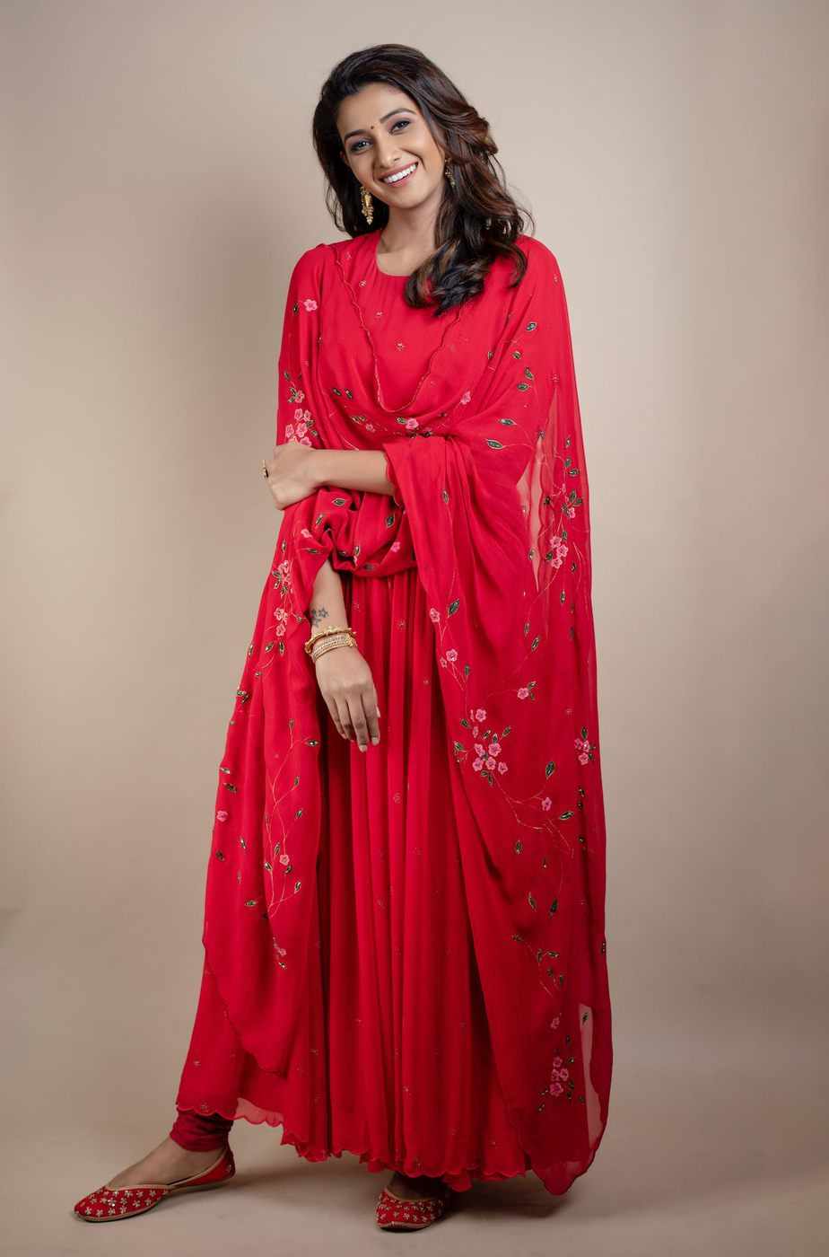 Priya Bhavani Shankar in a red shilpasutra anarkali