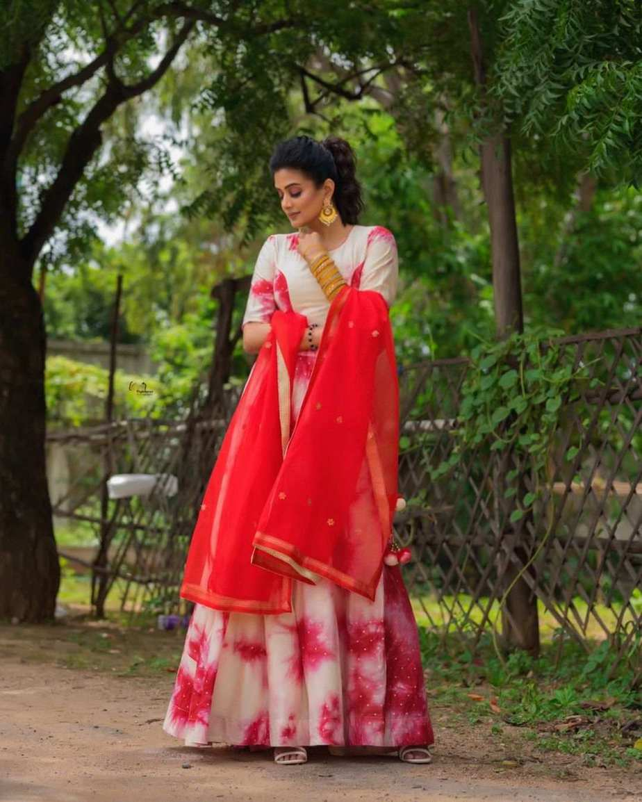 Priya Mani Raj in a red tie dyed lehenga by rivaj clothing for Dhee