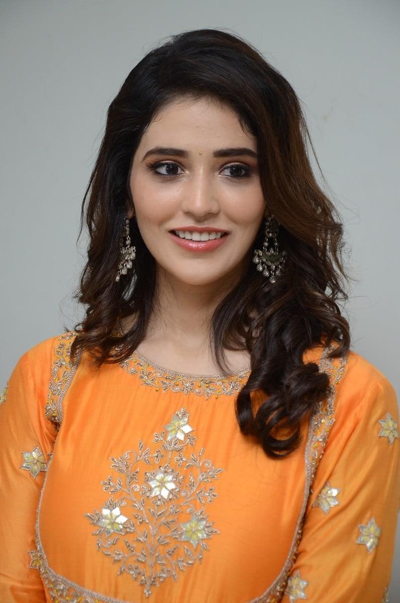 Priyanka Jawalkar in an orange outfit for gamanam movie press meet-4