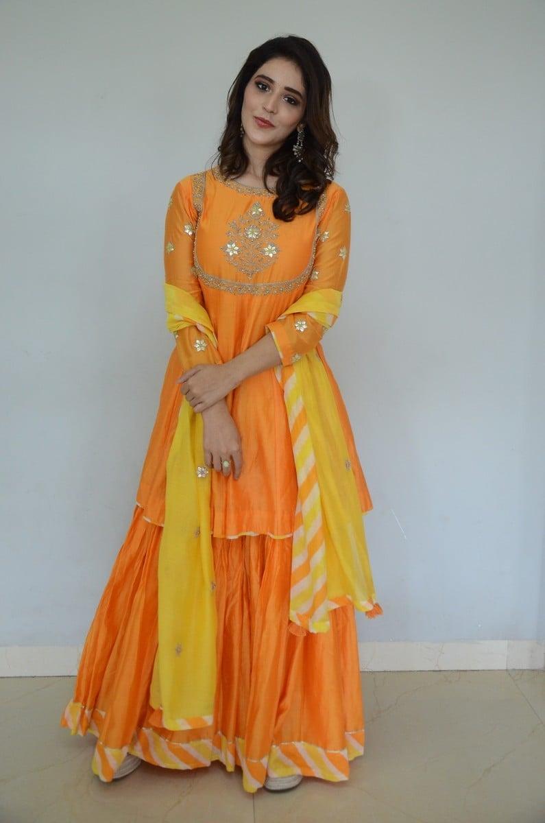 Priyanka Jawalkar in an orange sharara set for gamanam movie press meet