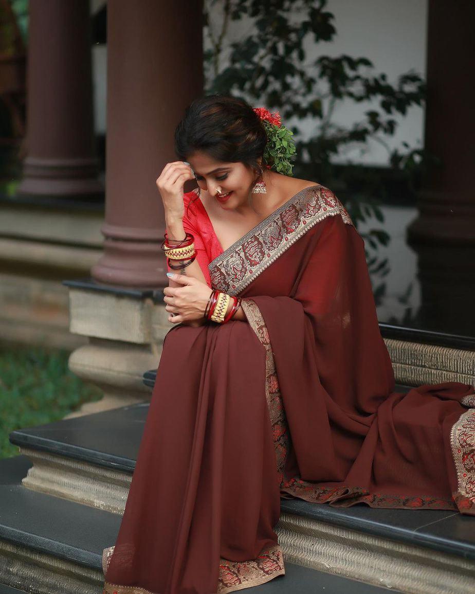 Ramya Nambessan in a brown saree by minka
