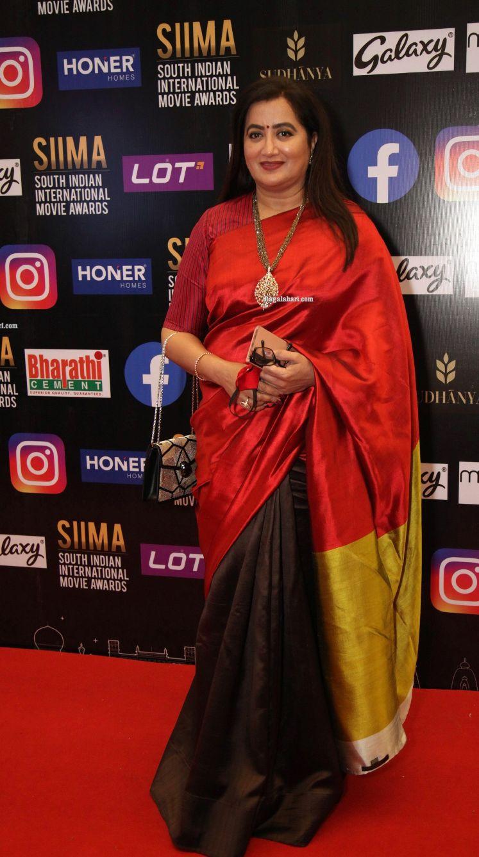Sumalatha Ambareesh in a multi coloured saree for SIIMA-2021