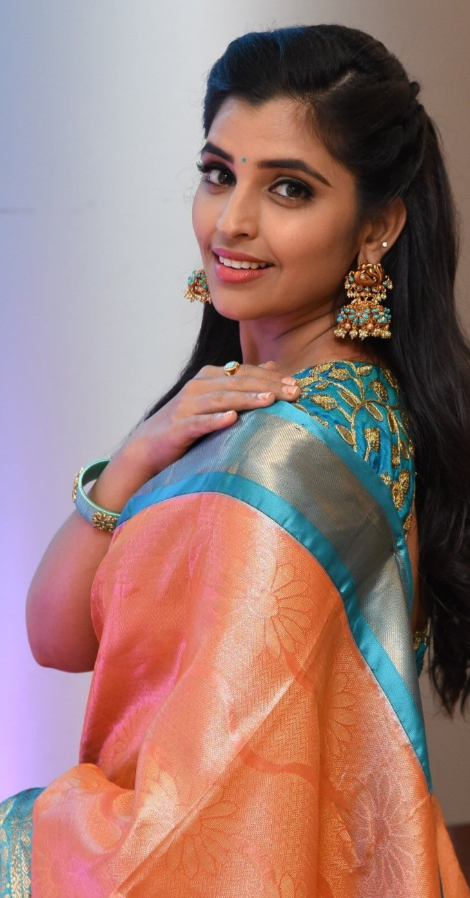 Syamala in a salmon pink pattu saree for style collections by Padma-2