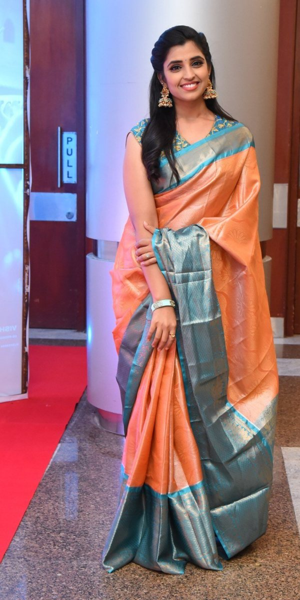 Syamala in a salmon pink pattu saree for style collections by Padma