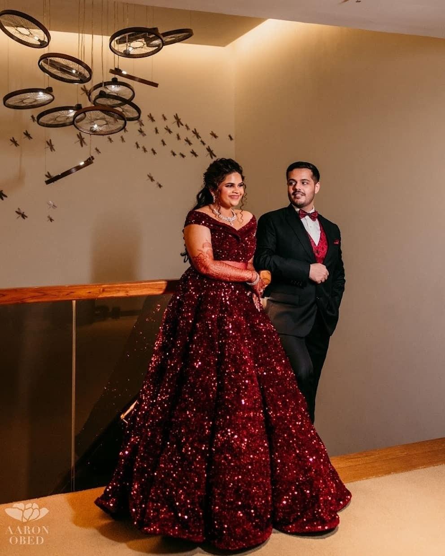 Vidyuraman in maroon gown for her reception