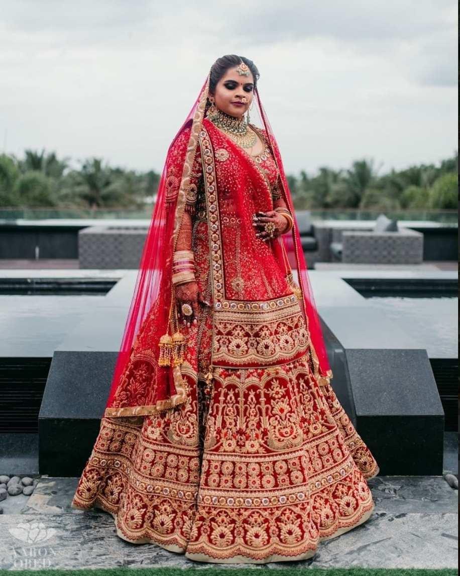 Vidyuraman in red tarun tahilani lehenga for north indian wedding