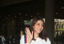 Kajal aggarwal in a white dress at the airport