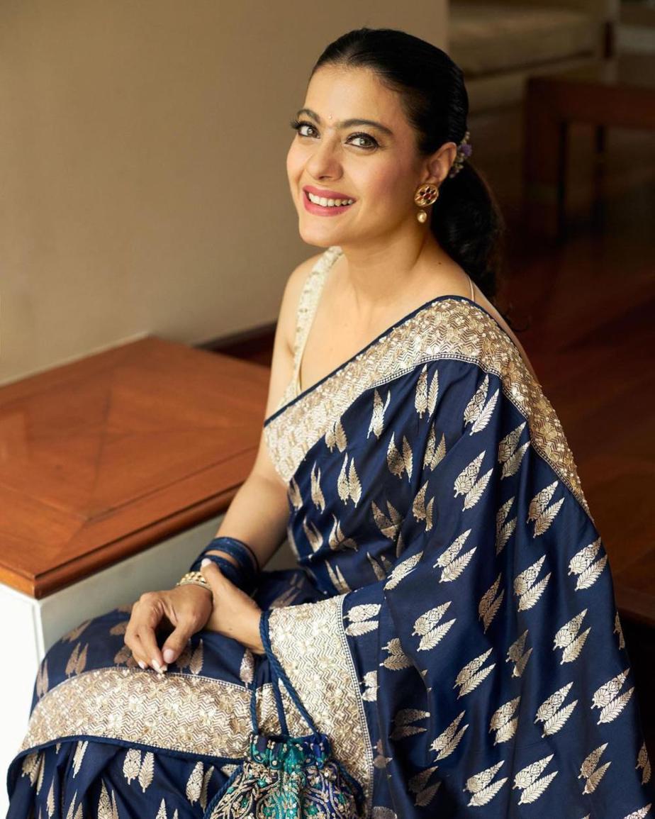 Kajol in a navy blue anita dongre saree for Durga Ashtami