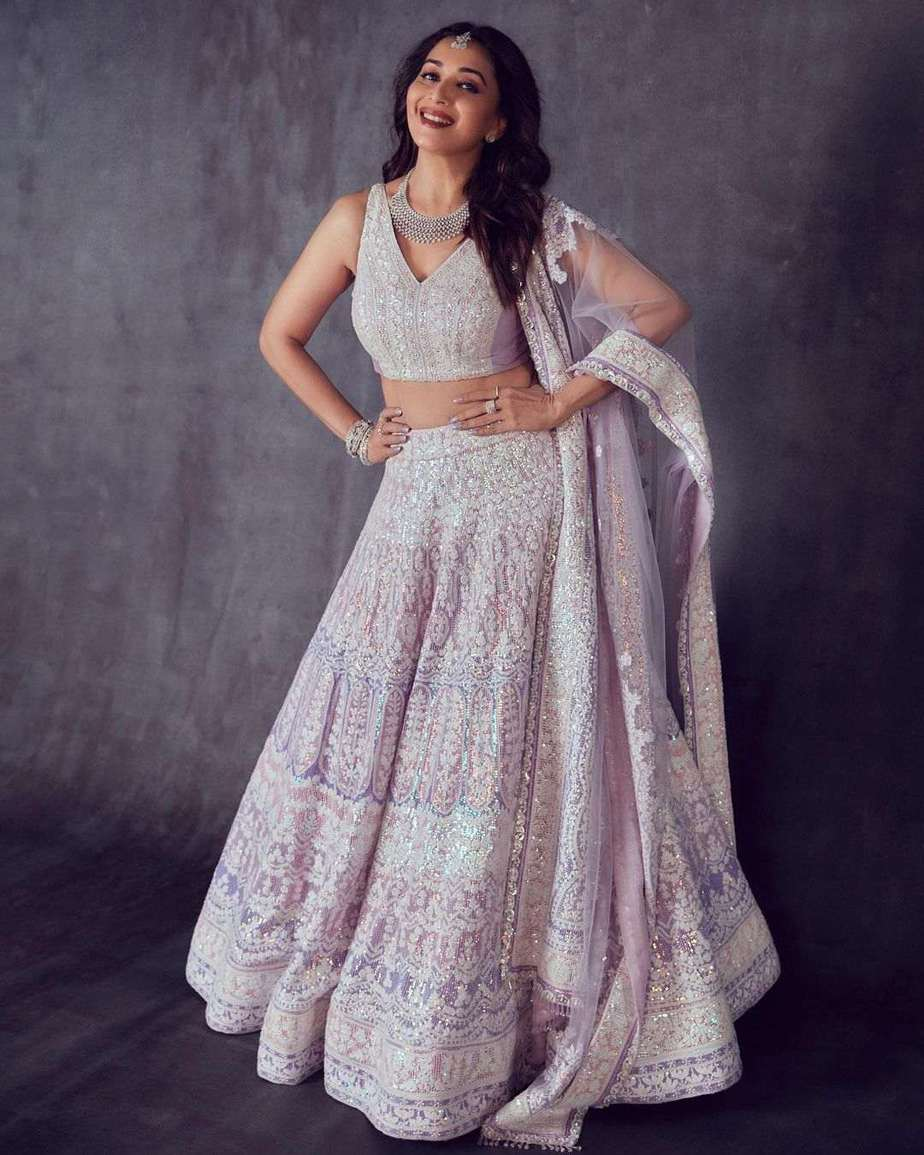 Madhuri Dixit in a lilac Manish Malhotra lehenga for DD-1