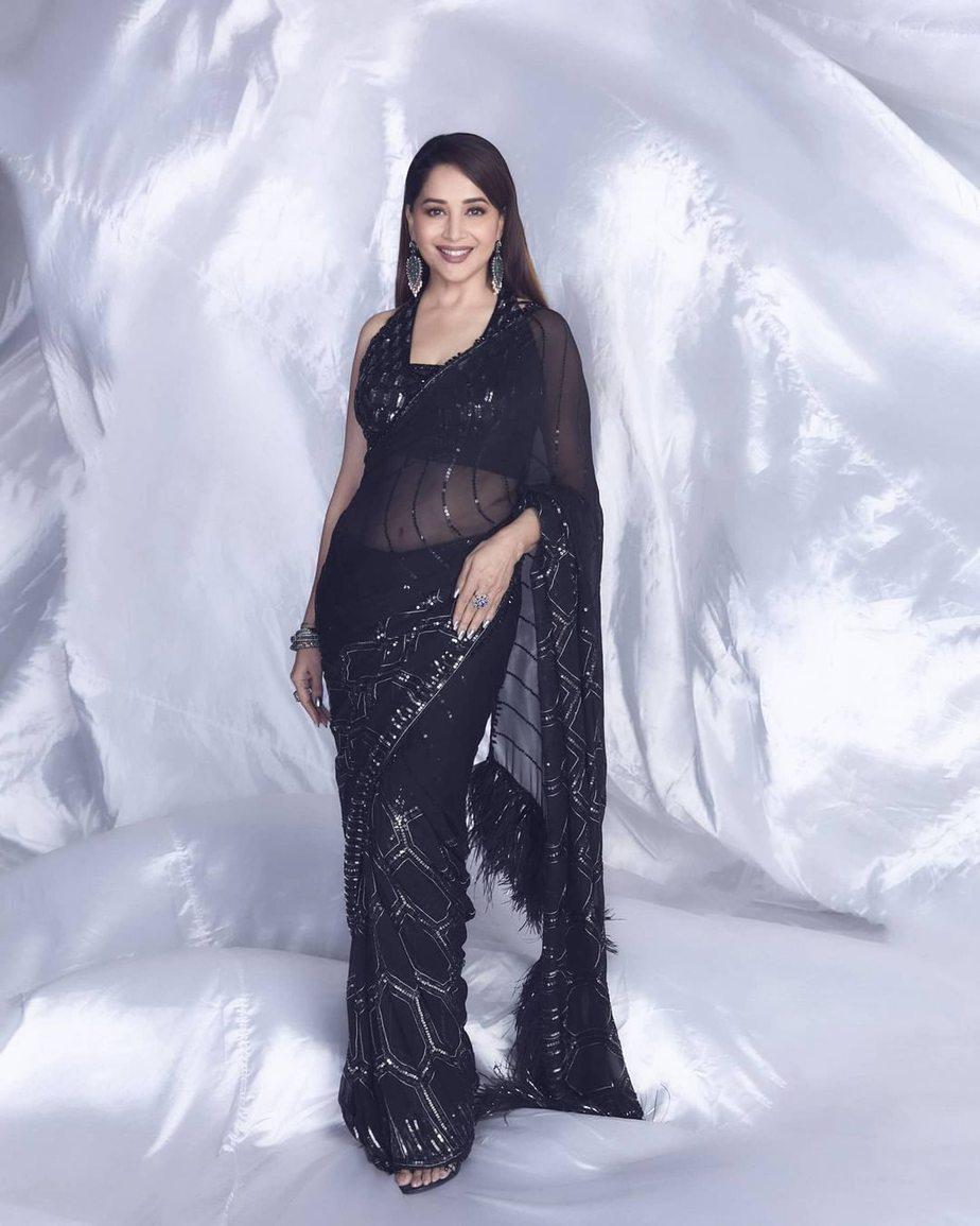Madhuri Dixit in black Manish Malhotra saree for dd