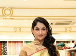 Sandhya Raju in a gold saree at a shop opening-
