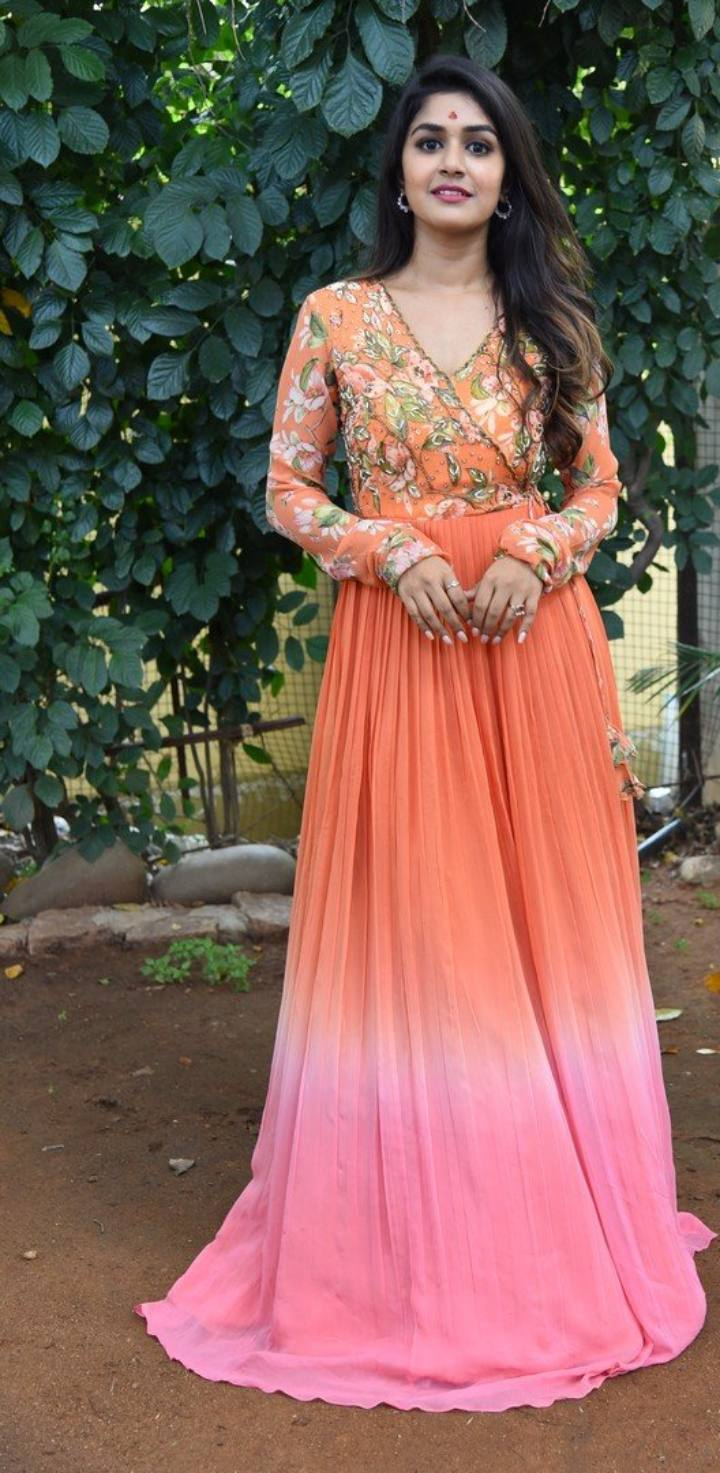 Sanjana Anand in an orange anarkali gown at new movie launch