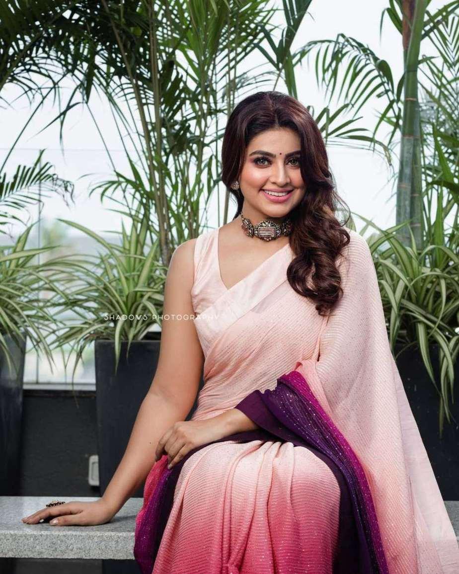 Sneha Prasanna in a pink saree by Geetha Haute couture