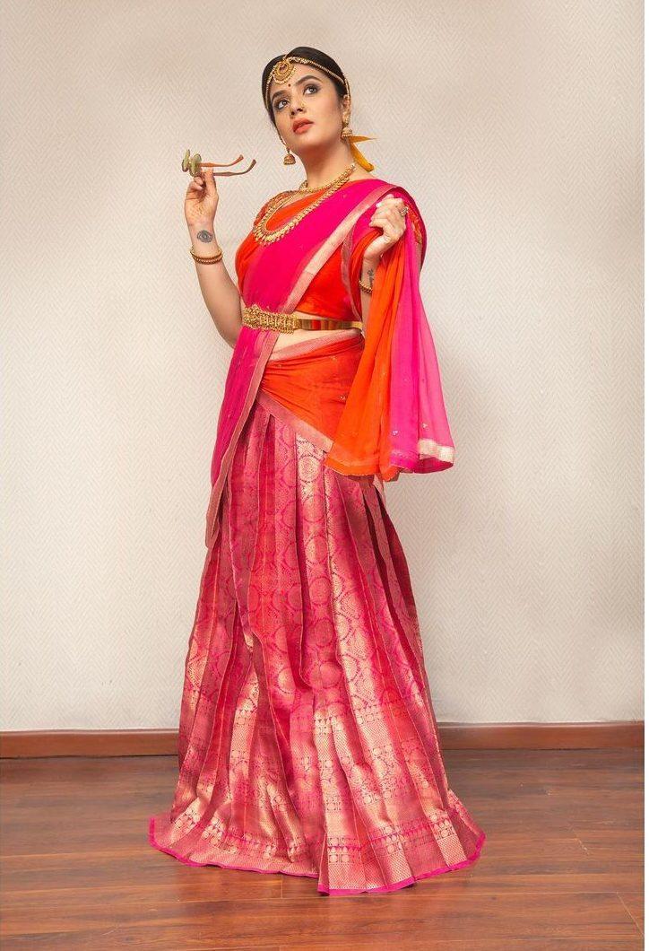 Sreemukhi in a pink pattu half saree by feathers btq