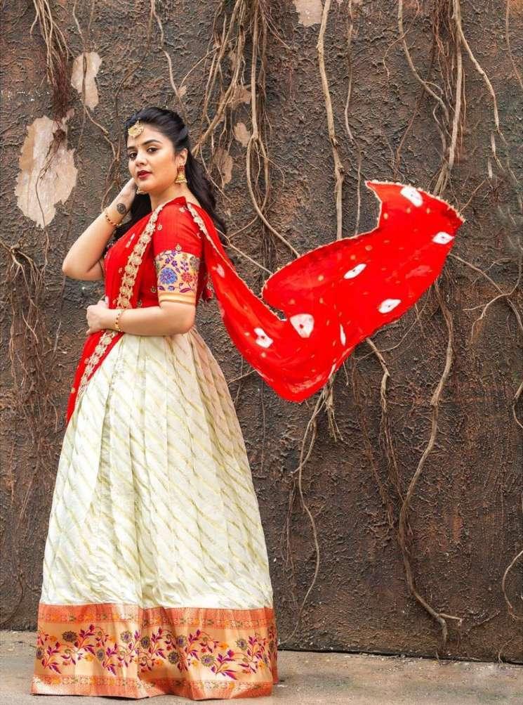 Sreemukhi in a red half saree by Kadambhari studio for comedy stars