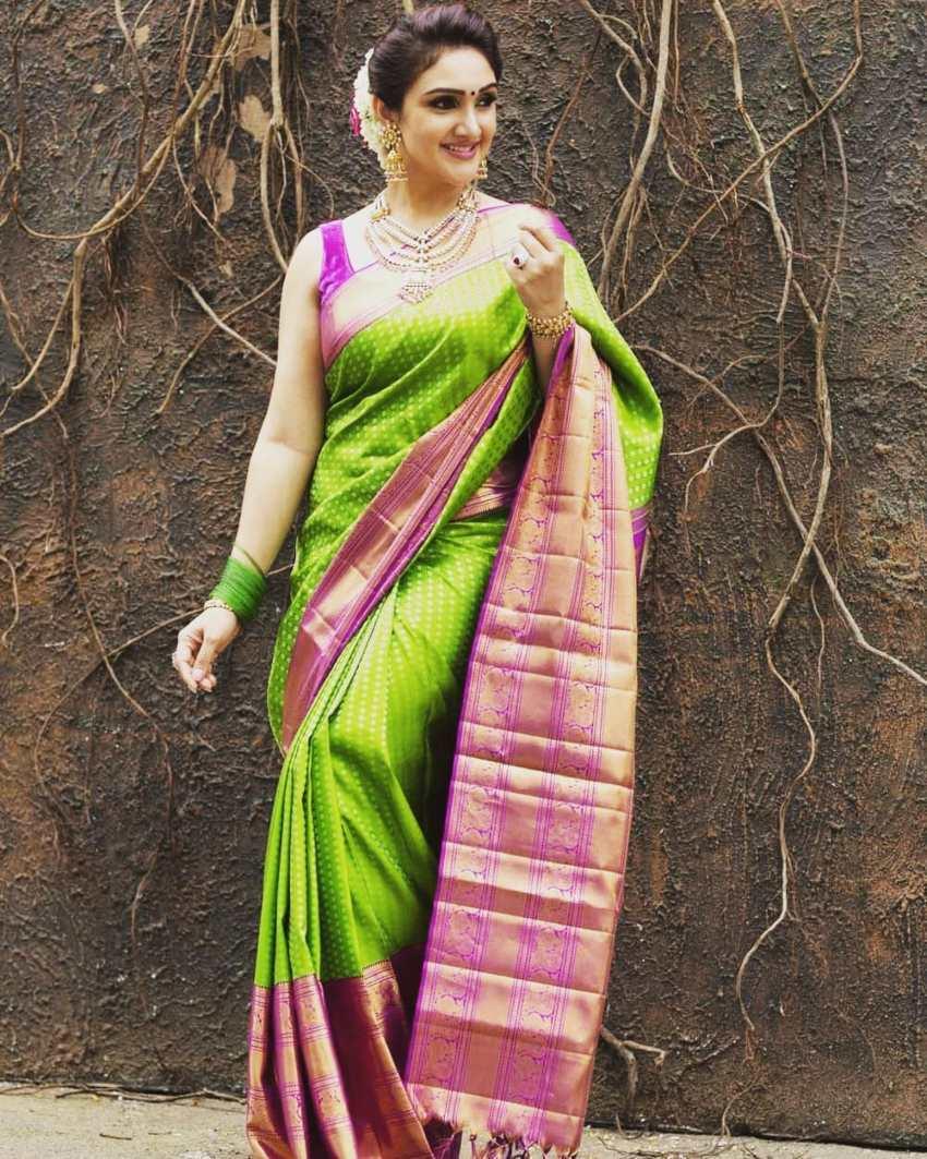Sridevi Vijaykumar in a parrot green pattu saree brand mandir -1