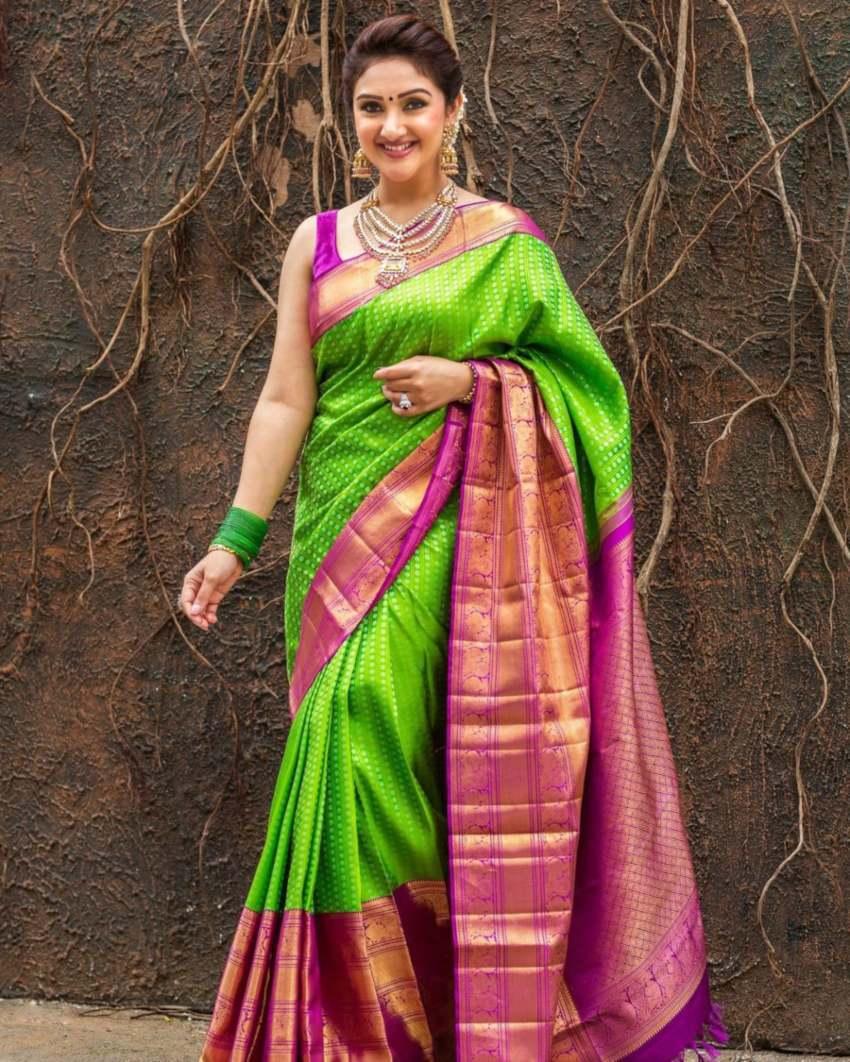 Sridevi Vijaykumar in a parrot green pattu saree brand mandir